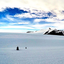 Researcher Riding Ski-Doos in Antarctica