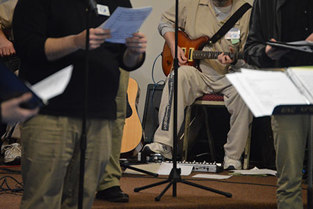 Inmates playing music at concert