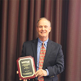 Bob Holdeman with the M. Stuart Hunter Award