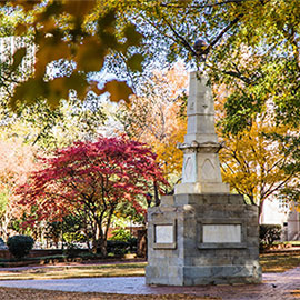 maxcy monument surrounded by fall foliage