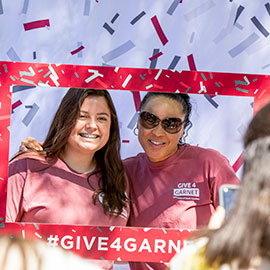 Dawn Staley poses with a fan on Greene Street during 2019 Give 4 Garnet event