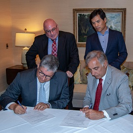 President Pastides, Dean Haemoon Oh, and Aruba officials signing the renewal