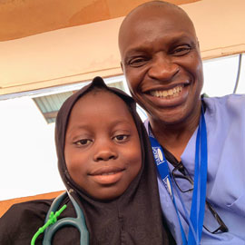 Cheedy Jaja and child at Sierra Leone clinic