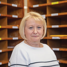 portrait of Sarah Kelly in the mail room