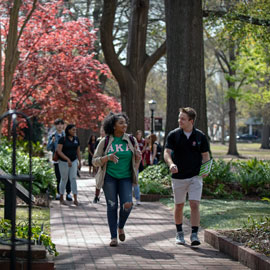 students walk along historic Horseshoe