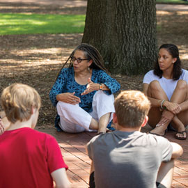 Poet Nikky Finney talks with students on the University of South Carolina Horseshoe