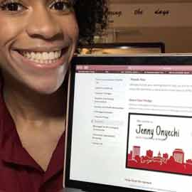 Selfie of Orientation Leader, Jenny Onyechi. She is holding her laptop up showing that she signed the pledge to columbia.
