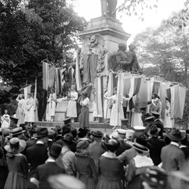 women rally for suffrage at a monument in washington DC in 1918