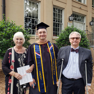 William Brown stands with family members at his graduation from UofSC
