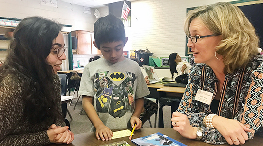 Beth White works with student and teacher