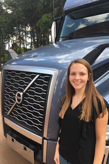 Sam Shuford next to a Volvo truck she drove for her internship.