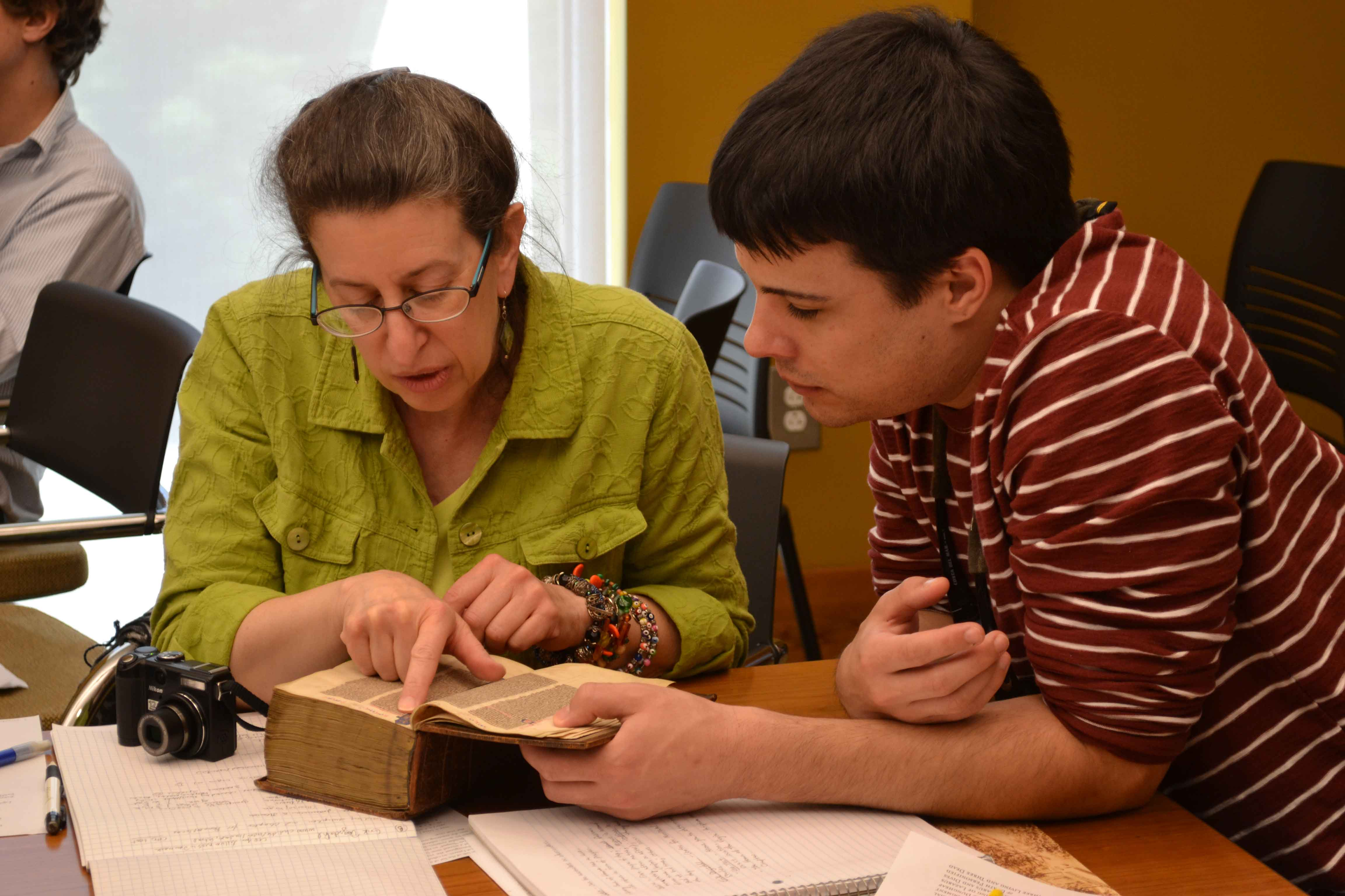 scholars studying medieval manuscripts