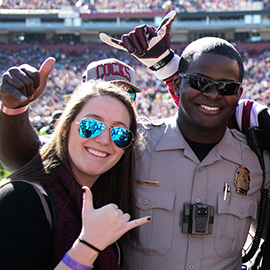 Students pose with UofSC public safety officers